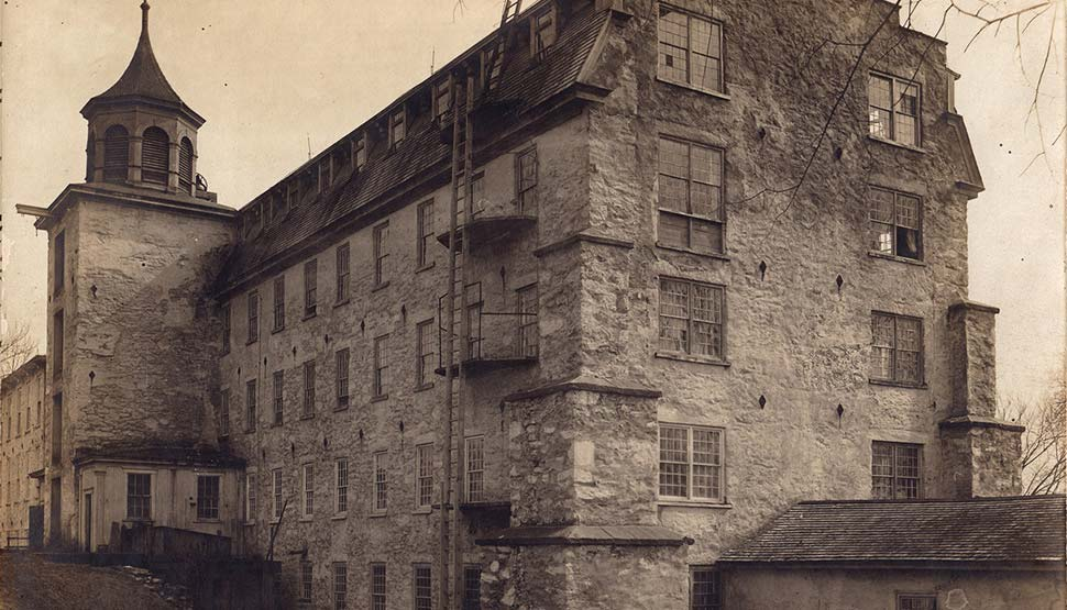 The historic Allendale Mill featured extra-thick plank floors, wooden roofing, shingles laid in mortar, a fire wall, central heating, the first rotary fire pump, pipes, hydrants and copper-riveted hoses. The mill originally produced broadcloth and later, cotton cloth.
